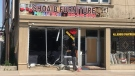 Officers responded to the crash at Shoaib Furniture at 760 Wyandotte St. E. in Windsor, Ont., on Tuesday, June 2, 2020. (Michelle Maluske / CTV Windsor)