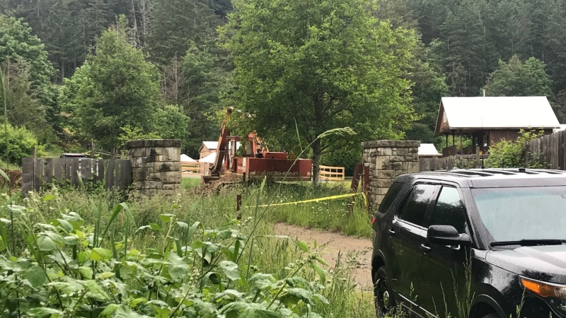 The Vancouver Island Integrated Major Crime Unit was at the scene Tuesday and had taped off a significant area around a house and what appears to be a wooden-fenced pen outside the home. (CTV News)
