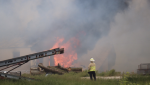 Crews battle a structure fire on Lakeshore Road 243 in Lakeshore, Ont. on June 2, 2020. (Courtesy OnLocation/Twitter)