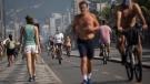 People exercise along the seashore at Ipanema beach in Rio de Janeiro, Brazil, Tuesday, June 2, 2020, amid the new coronavirus pandemic. (AP Photo/Silvia Izquierdo)
