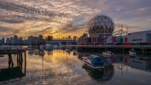 The sunset is seen by Vancouver's False Creek in May 2020. (Photo from Weather Watch app user Dkenz Yap)