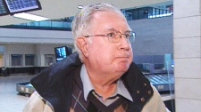 Raymond Lahey, former bishop of the Diocese of Antigonish, arrives at the Ottawa airport on Thursday, Oct. 1, 2009.