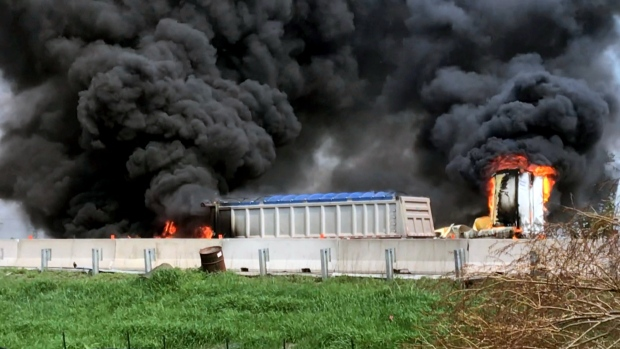 The scene of a fiery crash along Highway 401 in Milton, Ont. is seen.
