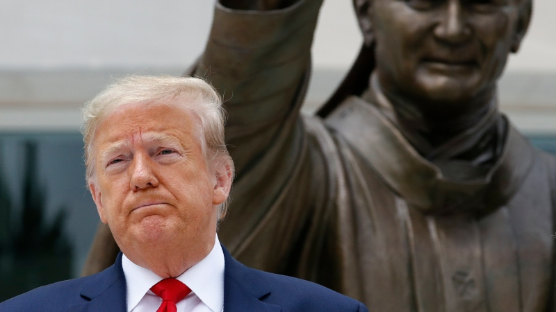 U.S. President Donald Trump visits Saint John Paul II National Shrine with first lady Melania Trump, Tuesday, June 2, 2020, in Washington. (AP Photo/Patrick Semansky)