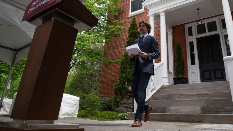 Prime Minister Justin Trudeau makes his way to the podium for a news conference outside Rideau Cottage in Ottawa, Tuesday June 2, 2020. THE CANADIAN PRESS/Adrian Wyld