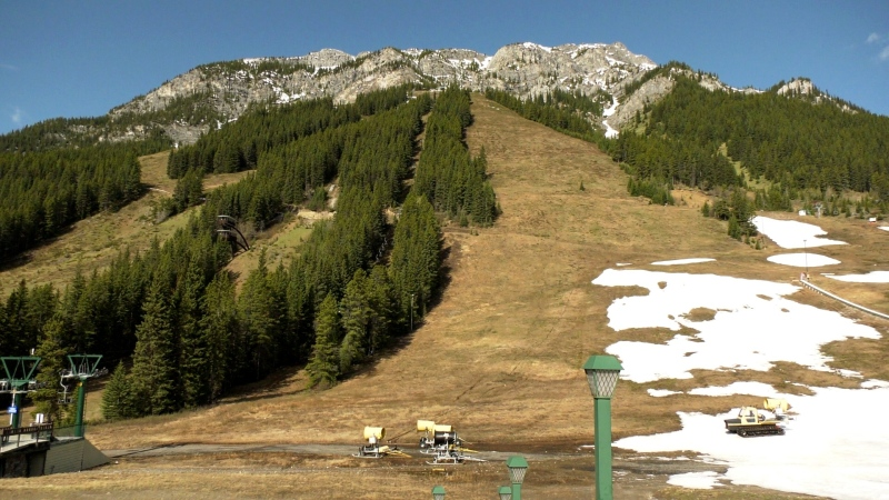 There's still some snow at the base of Mount Norquay but summer operations are set to start on a limited basis June 12.