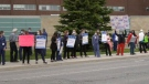 Frontline workers protest unequal pandemic pay