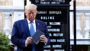 U.S. President Donald Trump holds a Bible as he visits outside St. John's Church across Lafayette Park from the White House Monday, June 1, 2020, in Washington. Part of the church was set on fire during protests on Sunday night. (AP Photo/Patrick Semansky)