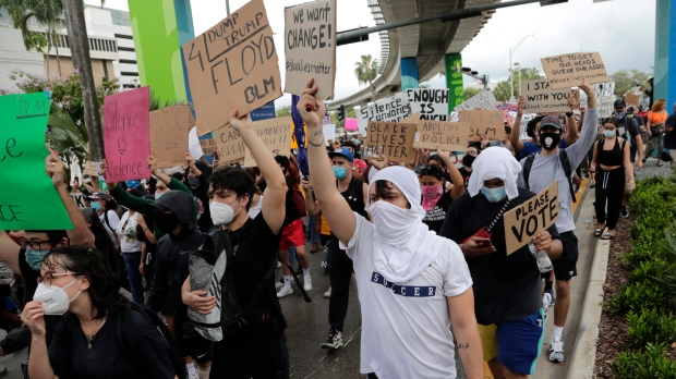 Protesters march through the streets over the death of George Floyd, Tuesday, June 2, 2020, in Miami. (AP / Lynne Sladky)
