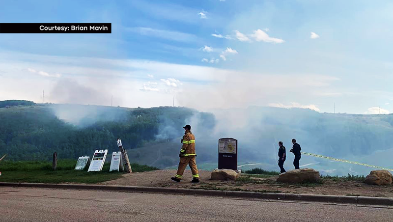 At least three grass fires were burning in Nose Hill Park Tuesday afternoon