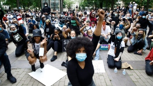 Demonstrators chant Tuesday, June 2, 2020, at Rittenhouse Square in Philadelphia, during a protest over the death of George Floyd, who died May 25 after he was restrained by Minneapolis police. (AP Photo/Matt Rourke)