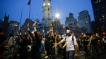 Demonstrators march Tuesday, June 2, 2020, near City Hall in Philadelphia, during a protest over the death of George Floyd, who died May 25 after he was restrained by Minneapolis police. (AP / Matt Rourke)