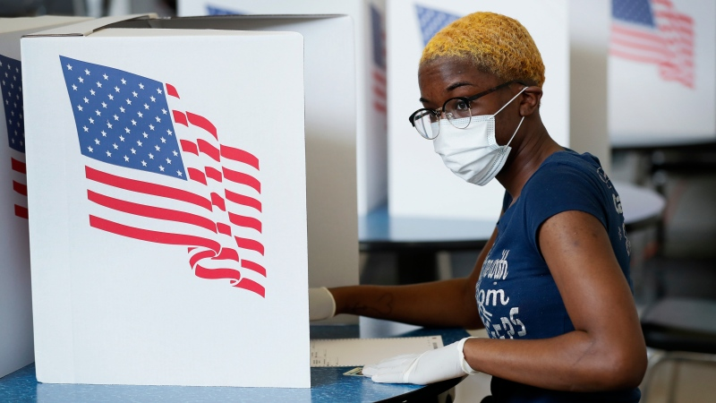 Princess Walker, of Des Moines, Iowa, fills out her ballot in Iowa's Primary Election at the Polk County Central Senior Center, Tuesday, June 2, 2020, in Des Moines, Iowa. (AP Photo/Charlie Neibergall)
