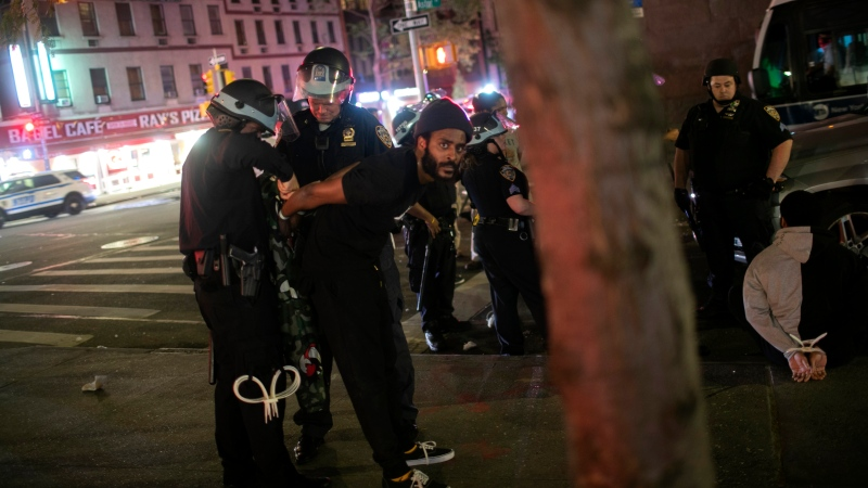 Police arrest people after curfew on Tuesday, June 2, 2020, in New York. (AP Photo/Wong Maye-E)