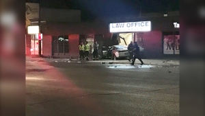 Images from the scene show the car crashed into a law office. (Source: Mason DePatie/CTV Winnipeg)