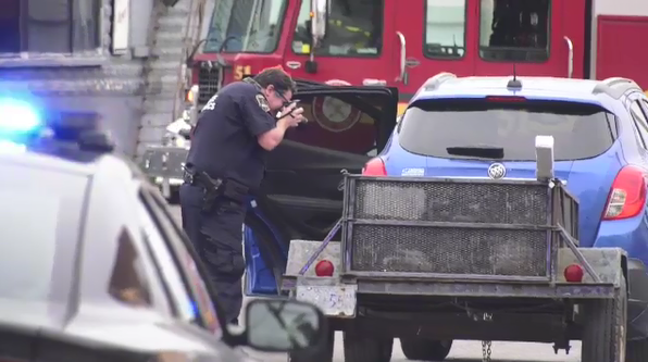 Officer photographing vehicle after crash
