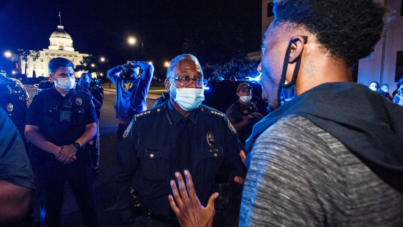 Montgomery Police Chief Ernest Finley speaks with protesters in front of the State Capitol in Montgomery, Ala., on June 1, 2020. (Mickey Welsh / The Montgomery Advertiser via AP)