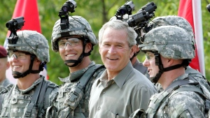 George W. Bush with military personnel during his visit to U.S. Army Special Operations Command at Fort Bragg, N.C., on July 4, 2006. (Pablo Martinez Monsivais / AP)
