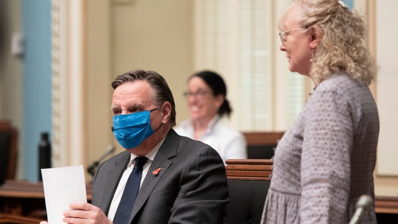 Quebec Minister Responsible for Seniors and Informal Caregivers Marguerite Blais, right, chats with Quebec Premier Francois Legault before question period Wednesday, June 3, 2020 at the legislature in Quebec City. THE CANADIAN PRESS/Jacques Boissinot