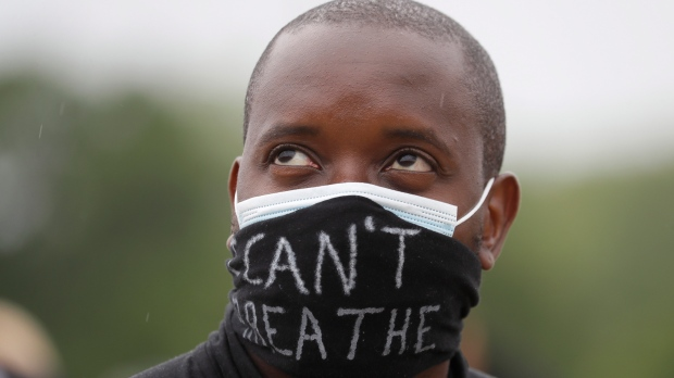 A man takes part in a demonstration on Wednesday, June 3, 2020, in Hyde Park, London, over the death of George Floyd, a black man who died after being restrained by Minneapolis police officers on May 25. (AP Photo/Kirsty Wigglesworth)