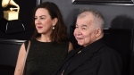 In this Feb. 10, 2019 file photo, Fiona Whelan Prine, left, and John Prine arrive at the 61st annual Grammy Awards in Los Angeles. The wife of the late celebrated singer-songwriter John Prine, who died from complications of COVID-19, is urging lawmakers to expand absentee voting so Tennesseans would not have to put their health at risk exercising their right to vote. Fiona Whelan Prine told a Senate panel Tuesday that allowing more people to cast an absentee ballot was critical in ensuring that people would remain safe and healthy during the 2020 election. Whelan Prine also contracted the coronavirus, but she has since recovered. (Photo by Jordan Strauss/Invision/AP, File)