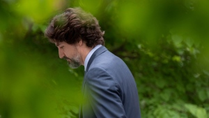 Prime Minister Justin Trudeau leaves a news conference as he returns to Rideau Cottage in Ottawa, Tuesday June 2, 2020. THE CANADIAN PRESS/Adrian Wyld