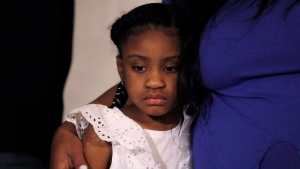 Gianna Floyd, the daughter of George Floyd, listens to a a news conference, Tuesday, June 2, 2020, in Minneapolis, Minn. The city has seen protests against police brutality sparked by the death of George Floyd, a black man who died after being restrained by Minneapolis police officers on May 25. (AP Photo/Julio Cortez)