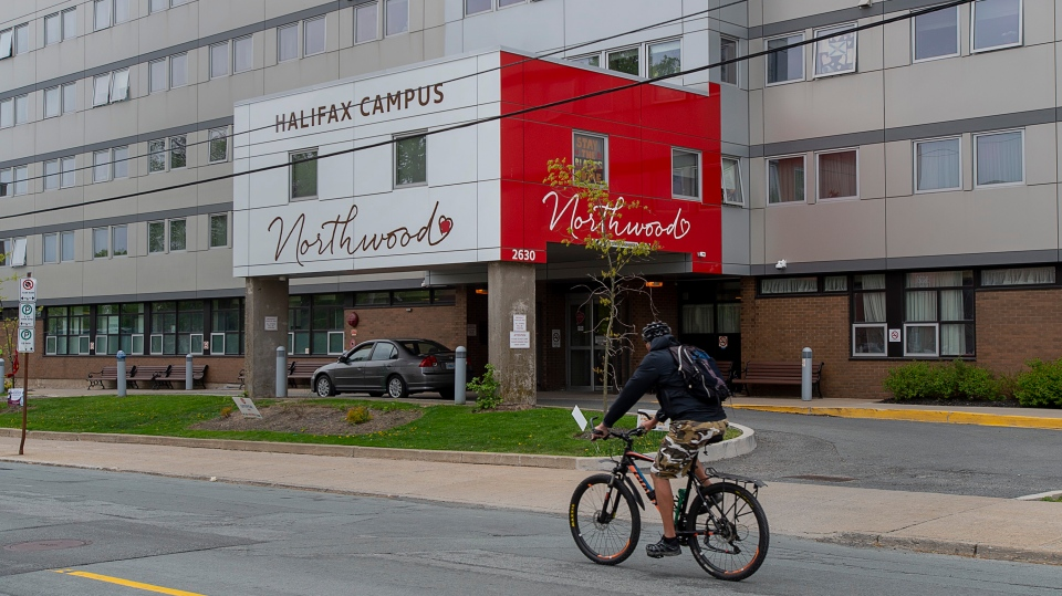 A cyclist heads past Northwood Manor, one of the largest nursing homes in Atlantic Canada, in Halifax on Tuesday, June 2, 2020. (THE CANADIAN PRESS/Andrew Vaughan)