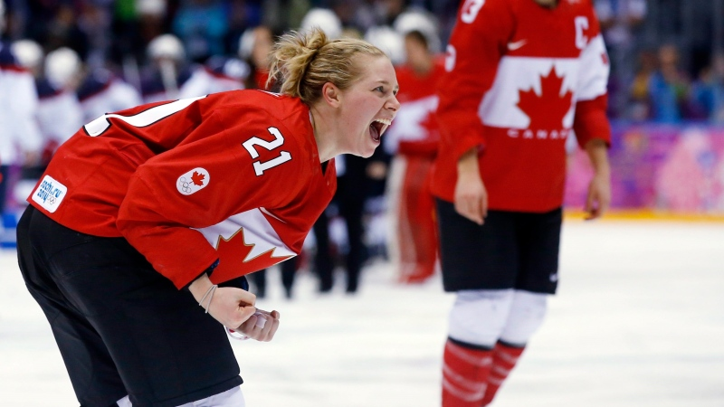 Haley Irwin of Canada (21) reacts after Canada beat the USA 3-2 to win the women's gold medal ice hockey game in overtime at the 2014 Winter Olympics, in Sochi, Russia, Thursday, Feb. 20, 2014. THE CANADIAN PRESS/AP-Matt Slocum
