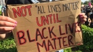 """""""NOT 'ALL LIVES MATTER' UNTIL BLACK LIVES MATTER period,"""" a sign reads. (Nicole Lampa / CTV Kitchener)"""