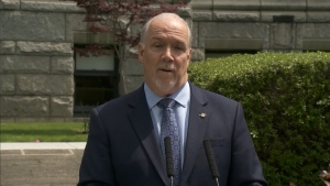 B.C. Premier John Horgan is seen in the Rose Garden outside the legislature on June 3, 2020.