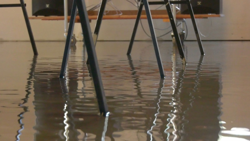 Significant amounts of water are in several of the buildings in Exshaw and residents say mitigation work could be to blame.