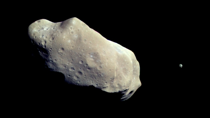 This file photo shows the asteroid 243 Ida and its moon Dactyl. (NASA)