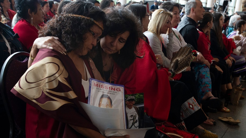 Two women embrace during ceremonies marking the release of the Missing and Murdered Indigenous Women report in Gatineau, Monday June 3, 2019. THE CANADIAN PRESS/Adrian Wyld