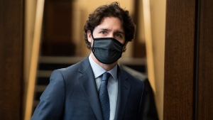 Prime Minister Justin Trudeau heads into the House of Commons at West Block on Parliament Hill in Ottawa, on Tuesday, June 2, 2020. (THE CANADIAN PRESS/Justin Tang)
