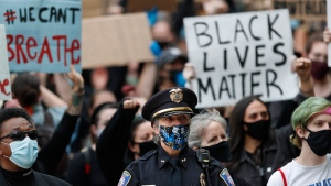 Westbrook Police Chief Janine Roberts attends a rally to peacefully protest and demand an end to institutional racism and police brutality, Wednesday, June 3, 2020, in Portland, Maine. (AP Photo/Robert F. Bukaty)