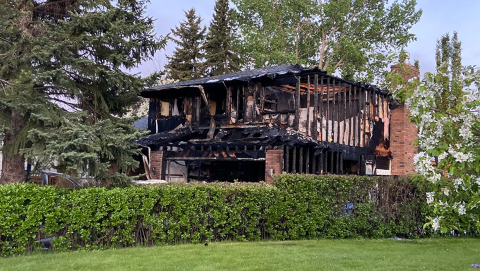 The charred frame of a home in the 5900 block of Dalcastle Dr. N.W. following a Thursday morning fire