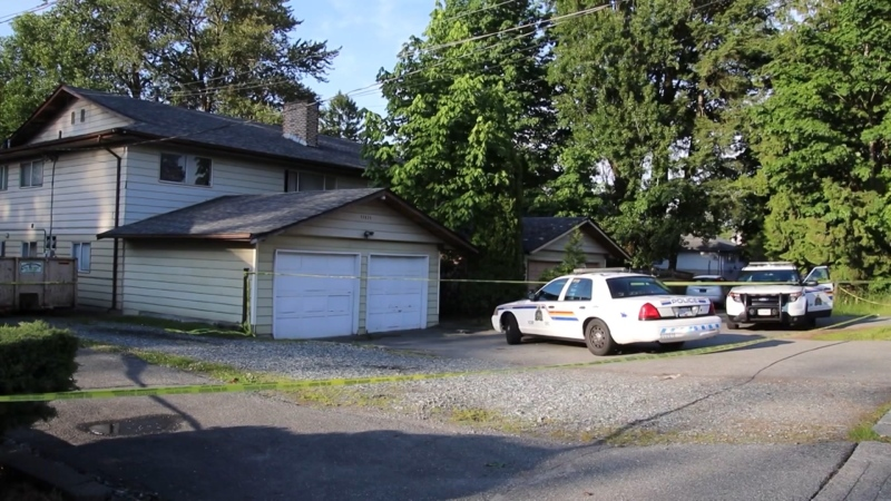 A Surrey home is behind police tape on Thursday, June 4. The investigation is believed to be linked to a recent suspicious death in the Whalley neighbourhood.
