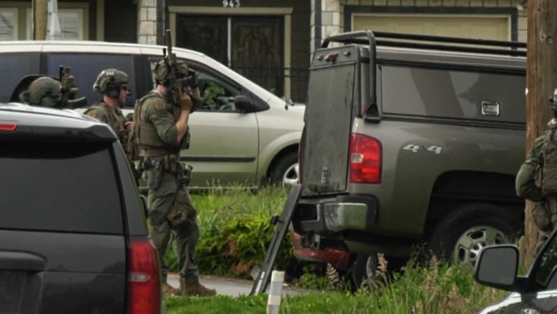 Dozens of heavily armed Mounties showed up to a house in Coquitlam on June 4, 2020.