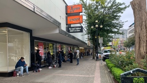 Customers line up outside Army & Navy in New Westminster for one final shoe sale before the store closes for good.