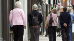 Senior citizens make their way down a street in Peterborough, Ont. in this 2012 file photo. THE CANADIAN PRESS/Frank Gunn