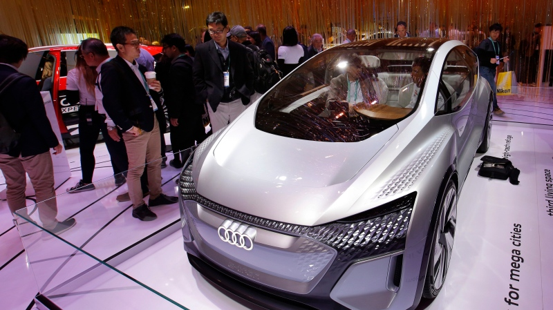 In this Jan. 8, 2020 file photo, the Audi AI:ME self-driving concept vehicle is on display in the Audi booth at the CES tech show in Las Vegas.  (AP Photo/John Locher, File)