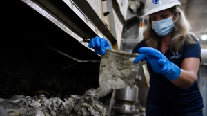 In this May 28, 2020, file photo Lyn Riggins, WSSC Water spokesperson, holds up a wipe that was collected along with other debris at a pumping station in Washington. (AP Photo/Susan Walsh)