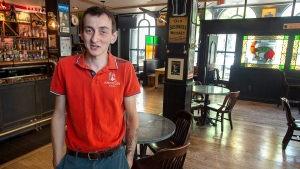 Brendan Doherty, co-owner of the Old Triangle Irish alehouse, stands in the newly arranged pub in Halifax on Thursday, June 4, 2020.  (THE CANADIAN PRESS/Andrew Vaughan)