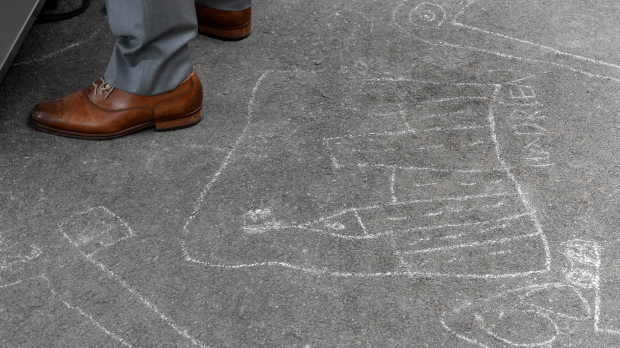 Chalk drawings showing the Peace Tower drawn by Hadrien Trudeau cover the ground as Prime Minister Justin Trudeau conducts a news conference outside Rideau cottage in Ottawa, Thursday June 4, 2020. (Adrian Wyld/THE CANADIAN PRESS)