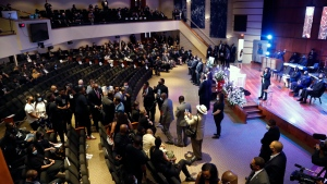 People fill Frank J. Lindquist Sanctuary at North Central University Thursday, June 4, 2020, before a memorial service for George Floyd in Minneapolis. (AP Photo/Julio Cortez)