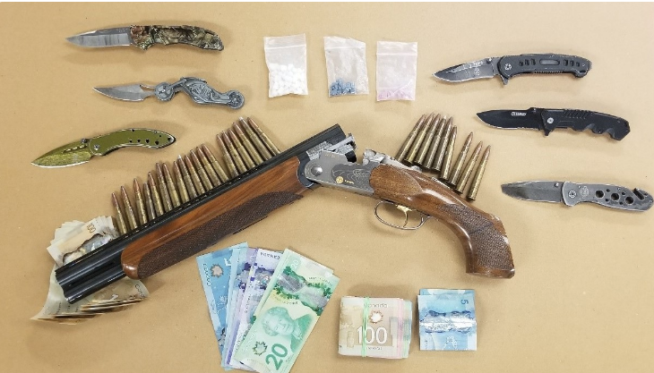 Recovered sawed-off shotgun, ammunition and drugs