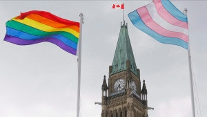 Pride flags are raised at a ceremony on Parliament Hill in Ottawa on Wednesday, June 20, 2018. THE CANADIAN PRESS/ Patrick Doyle