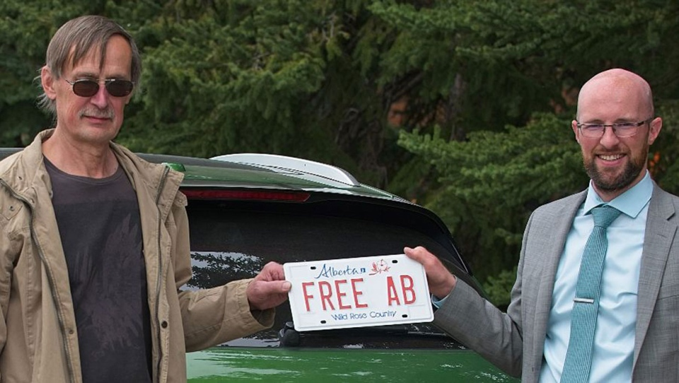 Tomas Manasek (left) appealed the Alberta Registrar of Motor Vehicles' decision to deny his use of the 'FREEAB' licence plate with the help of James Kitchen with the Justice Centre for Constitutional Freedoms. (Supplied/JCCF)
