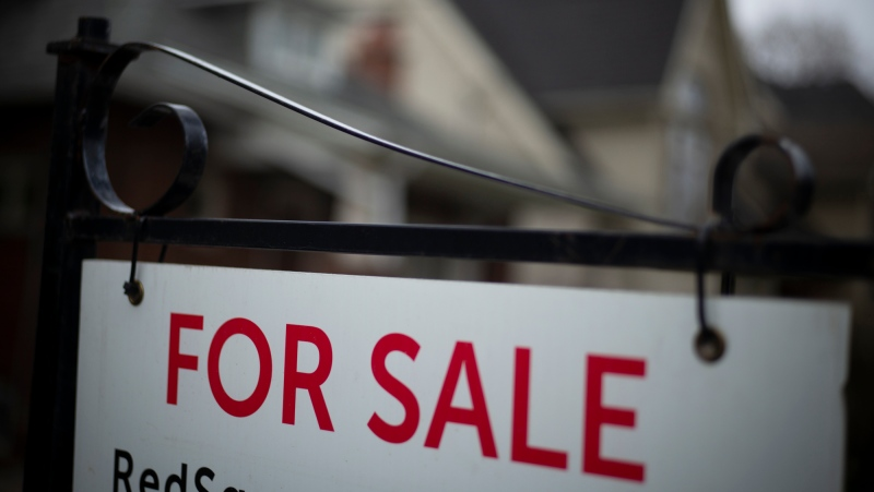 A home for sale sign is shown in a Toronto west end neighbourhood May 8, 2020. (THE CANADIAN PRESS / Graeme Roy)